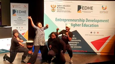 Drama students from Rhodes University performing a welcome introduction scene to illustrate an entrepreneurial sketch from the audience.