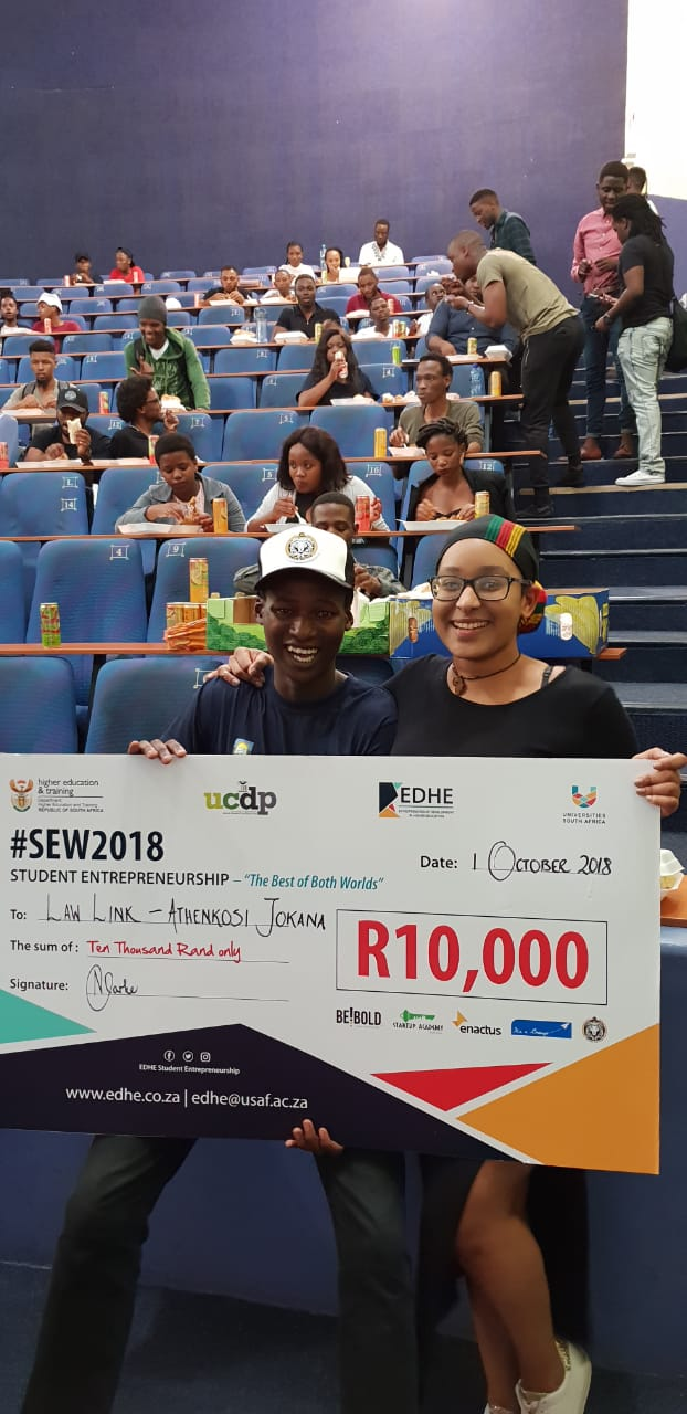 A very happy Athenkosi Jokana with his prize money and the lady behind the scenes who made the event possible.